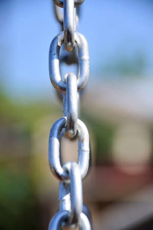 chain links: Chain Links - Shows a closeup of a metal chain link segment from a childrens swing set.