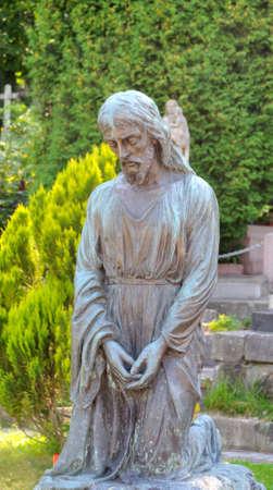 revere: Old statue in Lychakiv Cemetery in Lviv, Ukraine