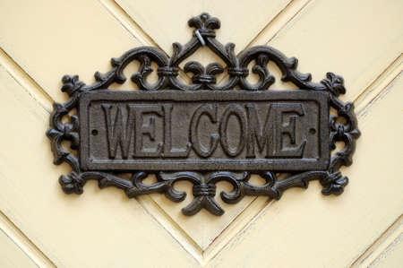 """the welcome: Reg�strate en la puerta """"bienvenida"""" Foto de archivo"""