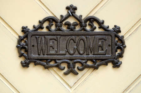 welcome symbol: Sign on the door welcome Stock Photo
