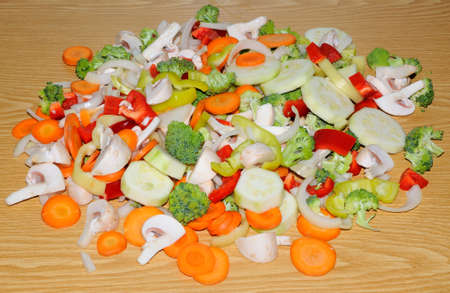 stir up: Miscellaneous fresh vegetables cut up in pieces ready for stir fry or saute. It includes carrots, broccoli, onions, asparagus, squash, and red and green pepper for healthy eating