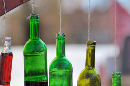 aligote: Bottle of wine hanging on a cord