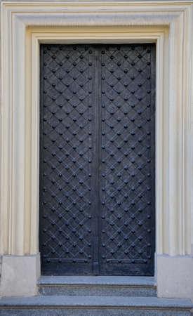 Vintage black iron door to church