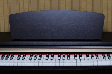 acoustically: Classical piano keys closeup with open lid