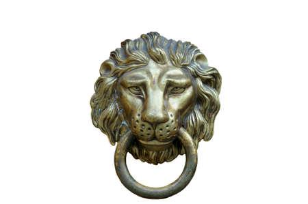 door handle: A brown door with beautiful bronze retro style carved lion head handle (knocker)