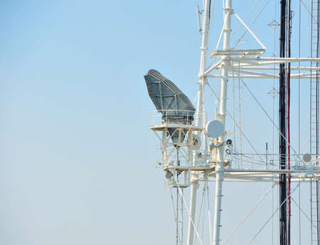 repeater: Mobile phone communication repeater antenna tower in blue sky