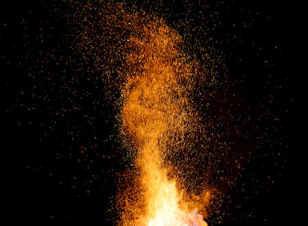 smithy fire flame tips with sparks closeup on dark background