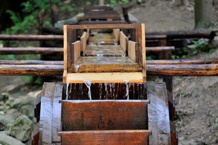 waterwheel: Wooden wheel of an ancient water mill in open-air museum,Ukraine.Lvov Stock Photo