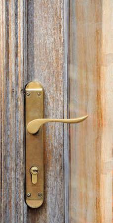 doorhandle: The iron doorhandle on the wooden doors Stock Photo