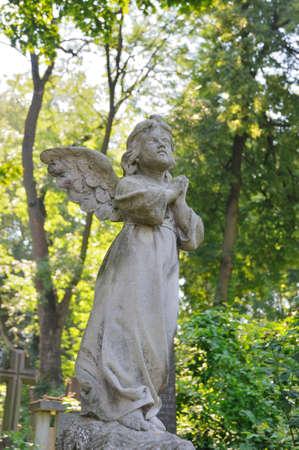 tumulus: Old statue in Lychakiv Cemetery in Lviv, Ukraine