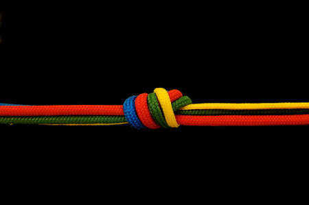climbing cable: Knot on a cord on a dark background Stock Photo