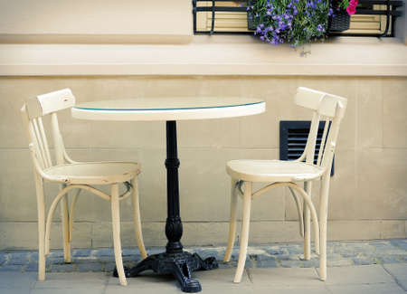 round chairs: Round table and two chairs Stock Photo