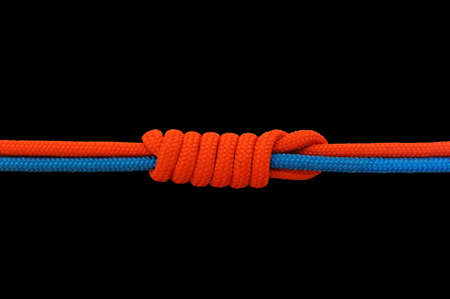 knot: Knot on a cord on a dark background Stock Photo