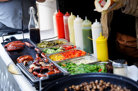 cafeteria tray: Tray with cooked food on showcase at cafeteria. Stock Photo