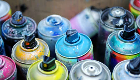 used cans of spray paint