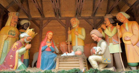 creche: Christmas Manger scene with figurines including Jesus, Mary, Joseph, sheep and magi.