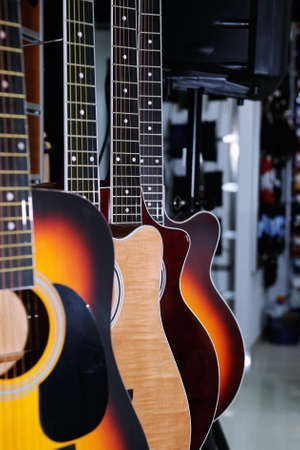 country store: Colorful acoustic guitars  in the store background