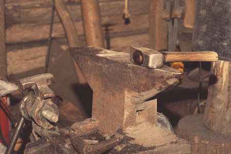 smithy: Tools for metal hammer on the anvil in the smithy Stock Photo
