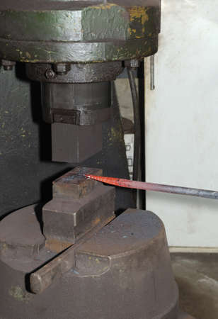 incus: Blacksmith hammering hot iron automatic hammer