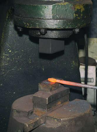 incus: Blacksmith hammering hot iron automatic hammer