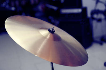 drum and bass: Cymbal closeup with drum set. Fragment drums