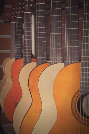 showwindow: The image of guitars on a show-window of musical shop Stock Photo