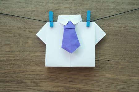 origimi: origami shirt on wooden background close-up Stock Photo