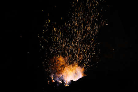 forge: Sparks from the fire in the forge on dark background Stock Photo
