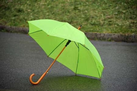 green umbrella closeup on a background of grass Stock Photo