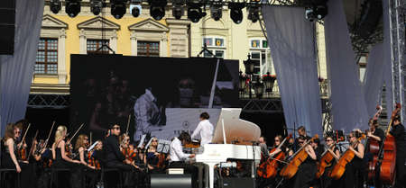 alfa: Lviv, Ukraine - June 2016: Alfa Jazz Fest 2016. Musicians bands INSO and Vadim Neselovskyi before the audience fans on stage jazz festival on the Market Square in Lviv near the town hall.
