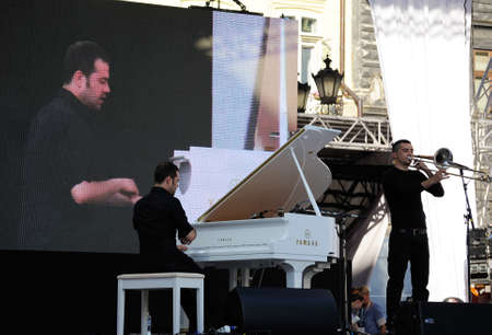 alfa: Lviv, Ukraine - June 2016: Alfa Jazz Fest 2016 Musicians duo Giovanni Guidi and Gianluca Petrella an audience of fans on stage jazz festival at Market Square in Lviv near City Hall