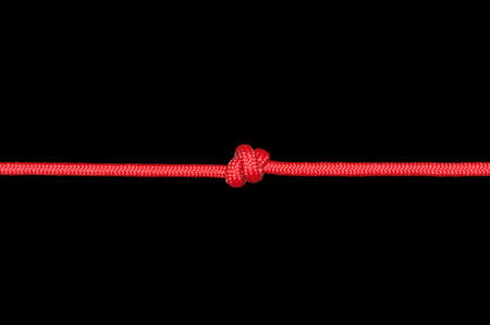 Knot on a cord on a dark background . Archivio Fotografico