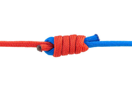 Two red and blue cords are connected . Knot on a cord isolated on a white background .
