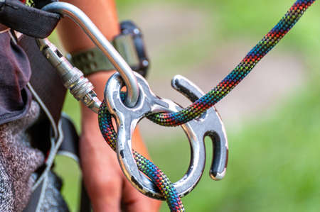 Climbing sports image of a carabiner on a rope close-up.