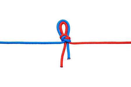 Two red and blue cords are connected. Knot on a cord isolated on a white background.