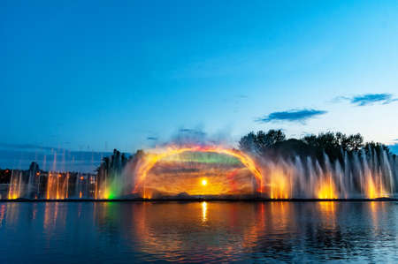 Musical fountain with laser animations. Night laser fountain show, on the Roshen embankment, the Ukrainian city of Vinnitsa.