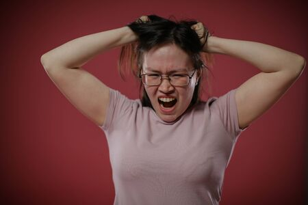 The woman tears her hair in anger.