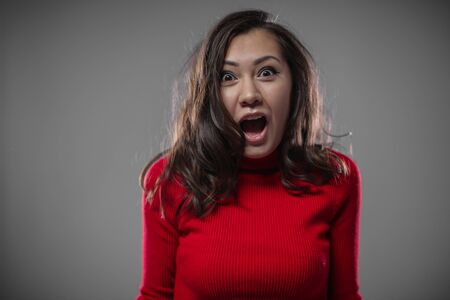 The girl screams with delight. Stock Photo - 133847252