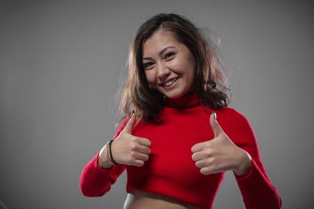 Girl shows gestures with thumb up. Its cool and great. Stock Photo