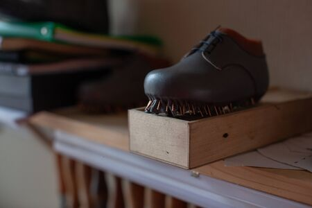 The blank of future handmade shoes stands on a stand