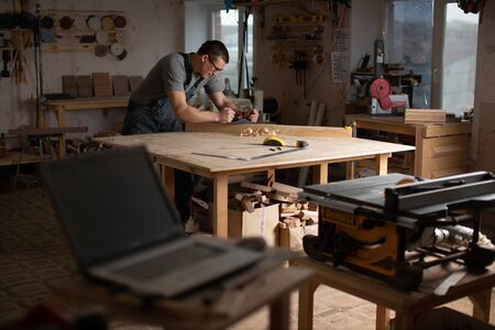 Carpentry workshop with equipment for the production of original furniture. Stock Photo