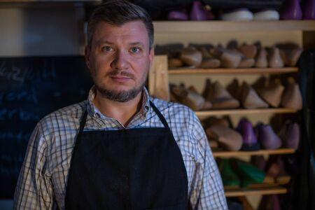 Portrait of a pleasant man-shoemaker