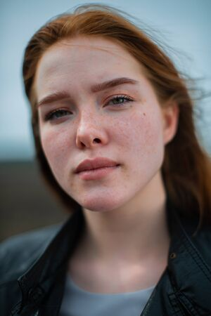 Portrait of a young girl with freckles. Stock Photo