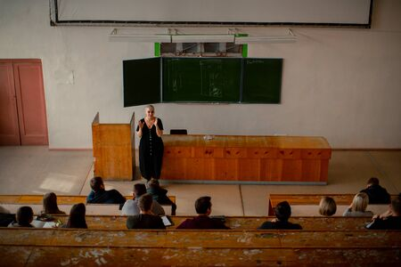 Top view of the classroom in which a female teacher teaches a lesson