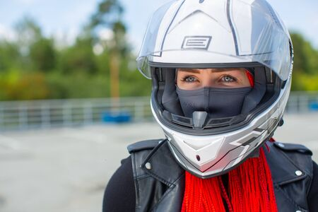 Portrait of a blue-eyed girl in a white helmet. Stock Photo