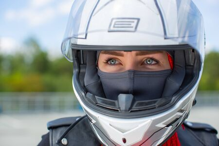 Girl with blue eyes in a helmet close-up. Stock Photo