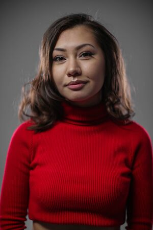 Portrait of a woman in a red turtleneck. Stock Photo