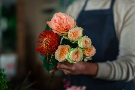 The process of assembling a flower bouquet. Stock Photo