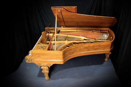 Studio Grand Piano.