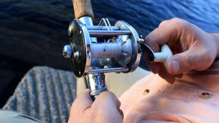 This is an image of demonstrating reeling in fish. 版權商用圖片